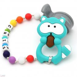 Pack Juguete Mordedor Para Carrito Personalizado Rainbow Mapache Turquesa
